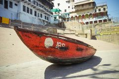 Varanasi, INDIA - MAY 29, 2017: Indian boat on the embankment of Varanasi near the holy river Ganges royalty free stock photography