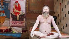 VARANASI, INDIA - MAY 2013: Naked Sadhu posing stock footage