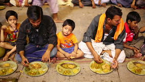 VARANASI, INDIA - MAY 2013: people eating free food at street stock video footage