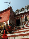 Hindu pilgrims climb the steps of a Shiva temple Royalty Free Stock Image