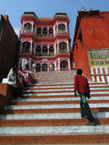 Hindu pilgrims climb the steps of a Shiva temple Royalty Free Stock Photography
