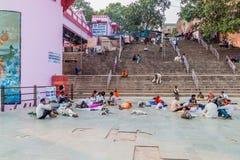 VARANASI, INDIA - OCTOBER 25, 2016: People at Dashashwamedh Ghat riverfront steps of the River Ganges in Varanasi, Ind. Ia royalty free stock photo
