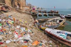 VARANASI, INDIA - OCTOBER 25, 2016: Pile of trash at a Ghat riverfront steps of sacred river Ganges in Varanasi, Ind. Ia stock image