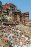 VARANASI, INDIA - OCTOBER 25, 2016: Pile of trash at a Ghat riverfront steps of sacred river Ganges in Varanasi, Ind. Ia royalty free stock photo