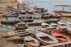 VARANASI, INDIA - OCTOBER 25, 2016: Small boats near Ghats riverfront steps leading to the banks of the River Ganges in. Varanasi, India stock images