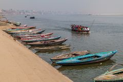 VARANASI, INDIA - OCTOBER 25, 2016: Small boats near Ghats riverfront steps leading to the banks of the River Ganges in. Varanasi, India royalty free stock photography