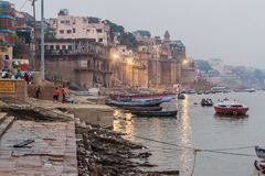 VARANASI, INDIA - OCTOBER 25, 2016: Small boats near Ghats riverfront steps leading to the banks of the River Ganges in. Varanasi, India stock photo