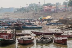 VARANASI, INDIA - OCTOBER 25, 2016: Small boats in River Ganges in Varanasi, Ind. Ia royalty free stock photography