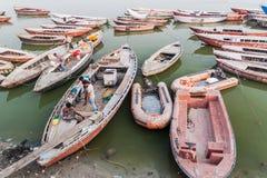 VARANASI, INDIA - OCTOBER 25, 2016: View of boats at sacred Ganges river in Varanasi, Indi. A stock photos