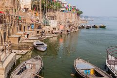 VARANASI, INDIA - OCTOBER 25, 2016: View of a Ghat riverfront steps of sacred river Ganges in Varanasi, Ind. Ia royalty free stock photography