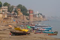 VARANASI, INDIA - OCTOBER 25, 2016: View of Ghats riverfront steps leading to the banks of the River Ganges in Varanasi. India royalty free stock photo