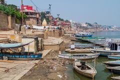 VARANASI, INDIA - OCTOBER 25, 2016: View of Ghats riverfront steps leading to the banks of the River Ganges in Varanasi. India stock photography