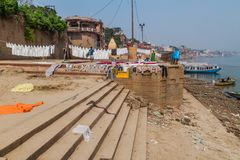VARANASI, INDIA - OCTOBER 25, 2016: View of Ghats riverfront steps leading to the banks of the River Ganges in Varanasi. India stock photo