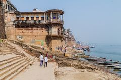 VARANASI, INDIA - OCTOBER 25, 2016: View of Ghats riverfront steps leading to the banks of the River Ganges in Varanasi. India royalty free stock photos