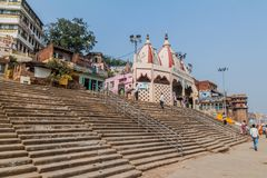 VARANASI, INDIA - OCTOBER 25, 2016: View of Ghats riverfront steps leading to the banks of the River Ganges in Varanasi. India royalty free stock photography