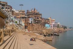 VARANASI, INDIA - OCTOBER 25, 2016: View of Ghats riverfront steps leading to the banks of the River Ganges in Varanasi. India stock image