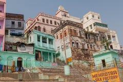 VARANASI, INDIA - OCTOBER 25, 2016: View of houses at sacred river Ganges riverfront in Varanasi, Ind. Ia royalty free stock photo