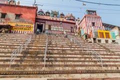 VARANASI, INDIA - OCTOBER 25, 2016: View of Kedar Ghat riverfront steps leading to the banks of the River Ganges in. Varanasi, India stock photos