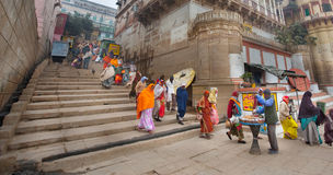 Varanasi - India. Pilgrims on ghat in the holy city of Varanasi situated on the bank of river Ganges - India Royalty Free Stock Photos
