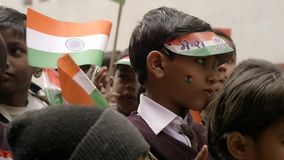 Varanasi, India, Republic Day, 26 January. Dancing children and flags. Republic Day honors the date on which the Constitution of India came into force on 26 stock video footage