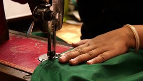 Varanasi, india, seamstress at work, close up. An Indian artisan in her workplace, detail close up stock video