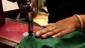 Varanasi, india, seamstress at work, close up stock video
