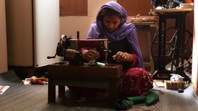Varanasi, india, seamstress at work. Portrait of an Indian artisan in her workplace stock video footage