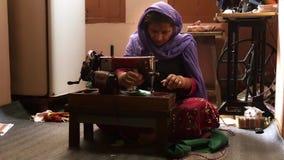 Varanasi, india, seamstress at work stock video footage