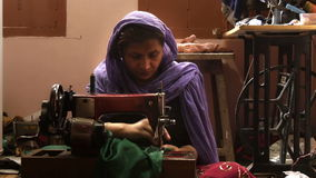 Varanasi, india, seamstress at work. Portrait of an Indian artisan in her workplace stock footage