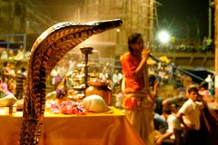 Varanasi, India - 16 september 2018: close up of young hindu priest performing daily ritual ganga aarti ceremony with fire and royalty free stock photo