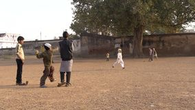 Varanasi, india, young boys playing cricket. Cricket is the most popular sport in India stock video
