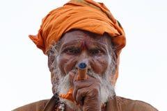 VARANASI, INIDA - MARCH 19, 2018: smoking sadhu royalty free stock photo