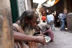 Varanasi. MP101: A old man eats roadside food at Varanasi, Uttar Pradesh, India Royalty Free Stock Image