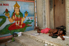 Varanasi. MP046: A sadhu sleeps on a ghat at Varanasi, Uttar Pradesh, India Royalty Free Stock Images