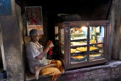 Varanasi. MP102: A shopkeeper sells sweets at Varanasi, Uttar Pradesh, India Royalty Free Stock Images