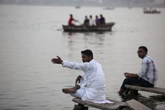 Varanasi. MP113: Tourists sit on the bank of River Ganges or Ganga at Varanasi, Uttar Pradesh, India Royalty Free Stock Images