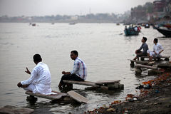 Varanasi. MP115: Tourists sit on the bank of River Ganges or Ganga at Varanasi, Uttar Pradesh, India Stock Image