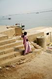 Varanasi. MP044: A woman sweeper cleans the ghat along the Ganger River or Ganga River in Varanasi, Uttar Pradesh, India Royalty Free Stock Photos