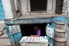 Varanasi. MP105: A young boy sells newspapers at Varanasi, Uttar Pradesh, India Stock Photography