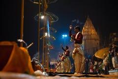 Varanasi Night Prayer Brahmin Priest Side Incense. VARANASI, INDIA - JANUARY 24, 2008: A row of unidentified hindu brahmin priests lead a night puja prayer stock images