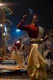 Varanasi Night Puja Brahmin Priest Facing Incense. VARANASI, INDIA - JANUARY 24, 2008: A row of unidentified hindu brahmin priests hold incense and lead a night Royalty Free Stock Photo