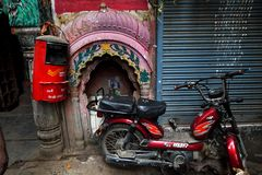 Varanasi. Postbox beside a small Hindu temple in a lane at Varanasi, Uttar Pradesh, India Stock Images