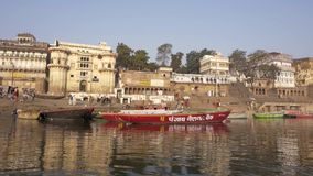 Varanasi is the spiritual capital of India. India, varanasi, people bathing in ganges river stock video footage