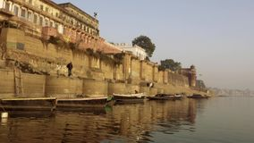 Varanasi is the spiritual capital of India. India, varanasi, people bathing in ganges river stock footage
