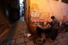 Varanasi. A tea vendor prepares tea at a roadside food stall at dawn at Varanasi, Uttar Pradesh, India Stock Photos