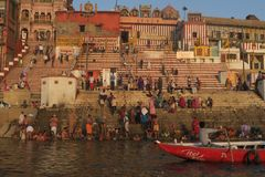 Young men swimming in the river of Ganges as a religious tradition. Varanasi, Uttar Pradesh India - March 25, 2017, ritual with pilgrims bathing in the Ganges stock photography