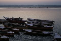 Evening water scene with lights and boats on the river of Ganges. Varanasi, Uttar Pradesh India - March 25, 2017, ships on water on the Ganges river stock images
