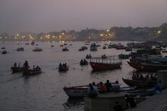 Evening water scene with lights and boats on the river of Ganges. Varanasi, Uttar Pradesh India - March 25, 2017, ships on water on the Ganges river royalty free stock photography