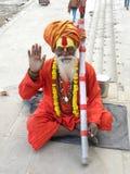 Varanasi, Uttar Pradesh, India - November 3, 2009 Hindu Ascetic blessing and sitting on the. Hindu Sadhu Baba with orange clothes and white beard blessing and stock photos