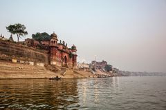 Varanasi, Uttar Pradesh, India. A view from River Ganges of Old. Historical Varanasi city with weathered buildings at the time of Sunrise stock photos